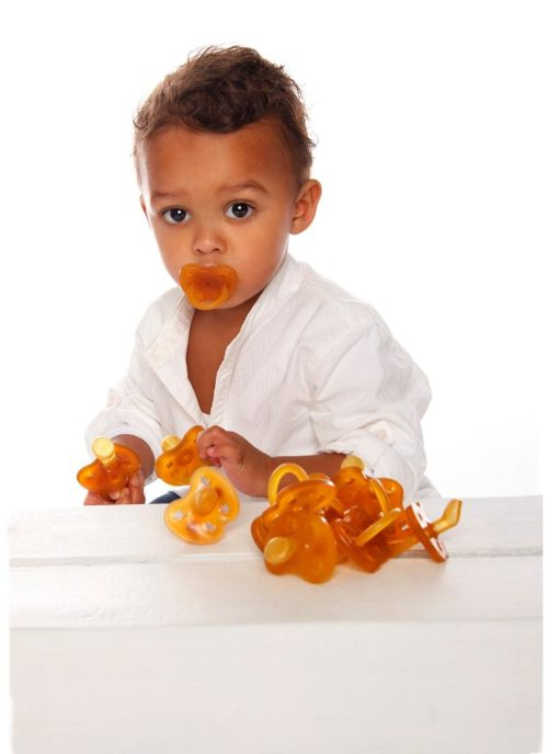 Boy with Hevea Pacifier